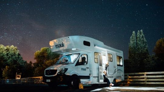 RV camper at campground night people relaxing