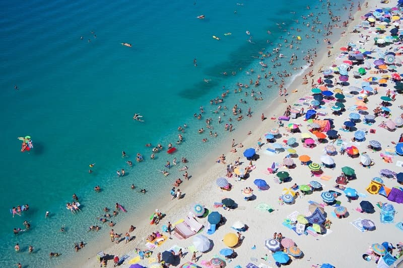 peak season at the beach in Tropea Italy is full of crowds of tourists