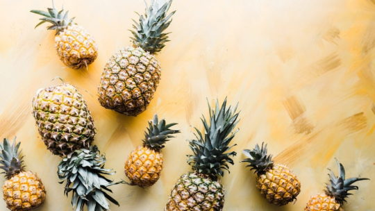 pineapples on yellow background image